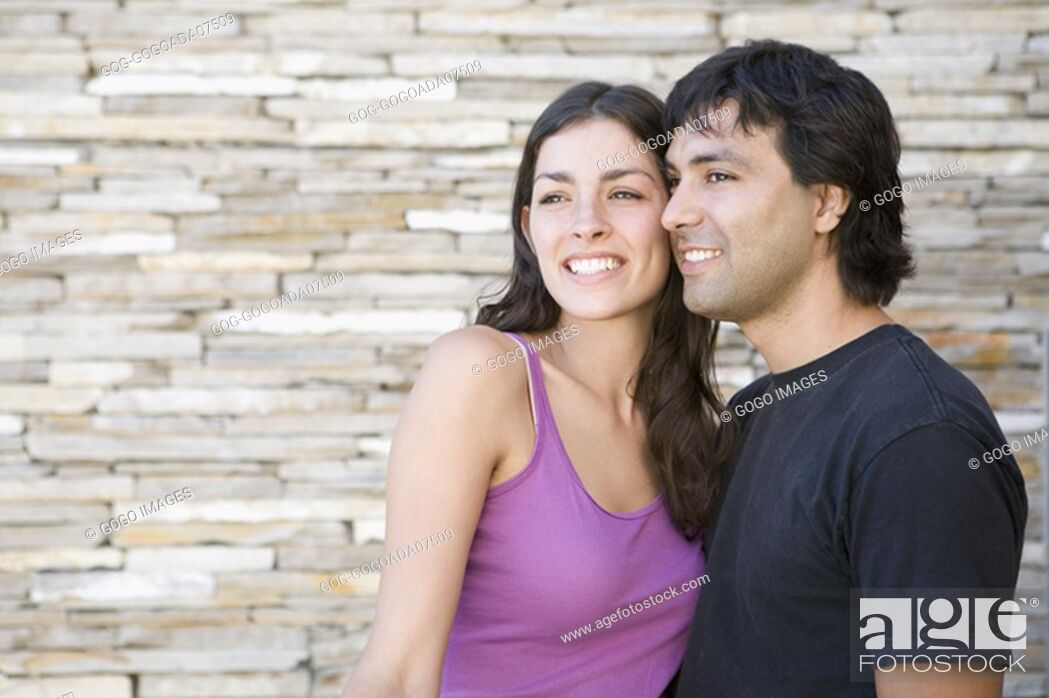 Stock Photo: Couple smiling outdoors.