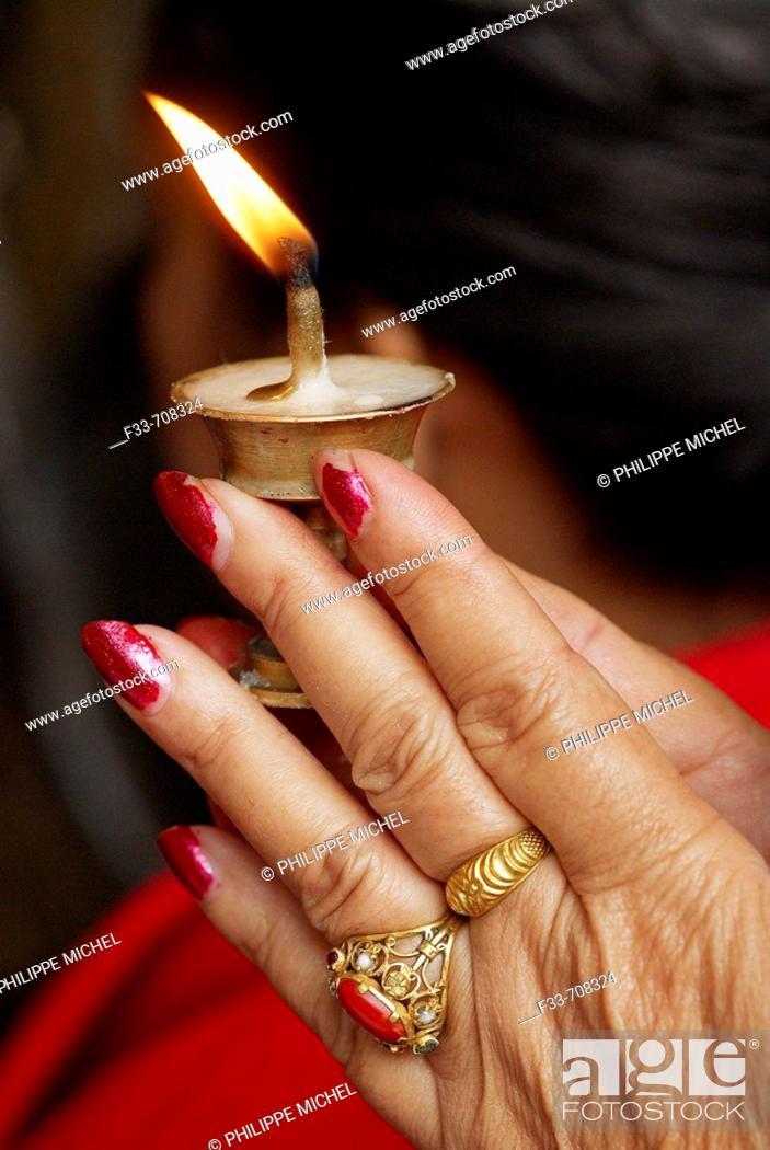 Stock Photo: Nepal. Kathmandu. Morning offering at the bouddhist temple of Sweta Macchendranath.