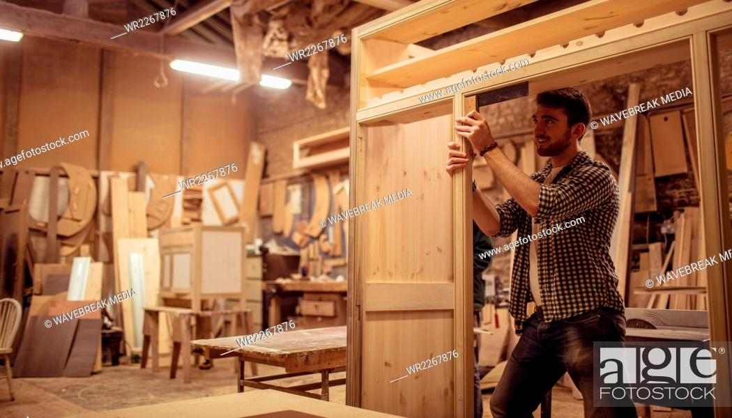 Stock Photo: Carpenter working on his craft.