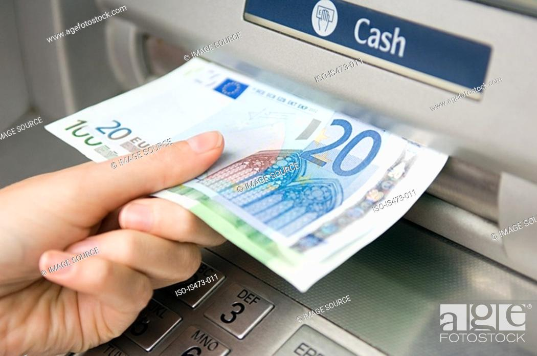 Stock Photo: Person withdrawing cash.