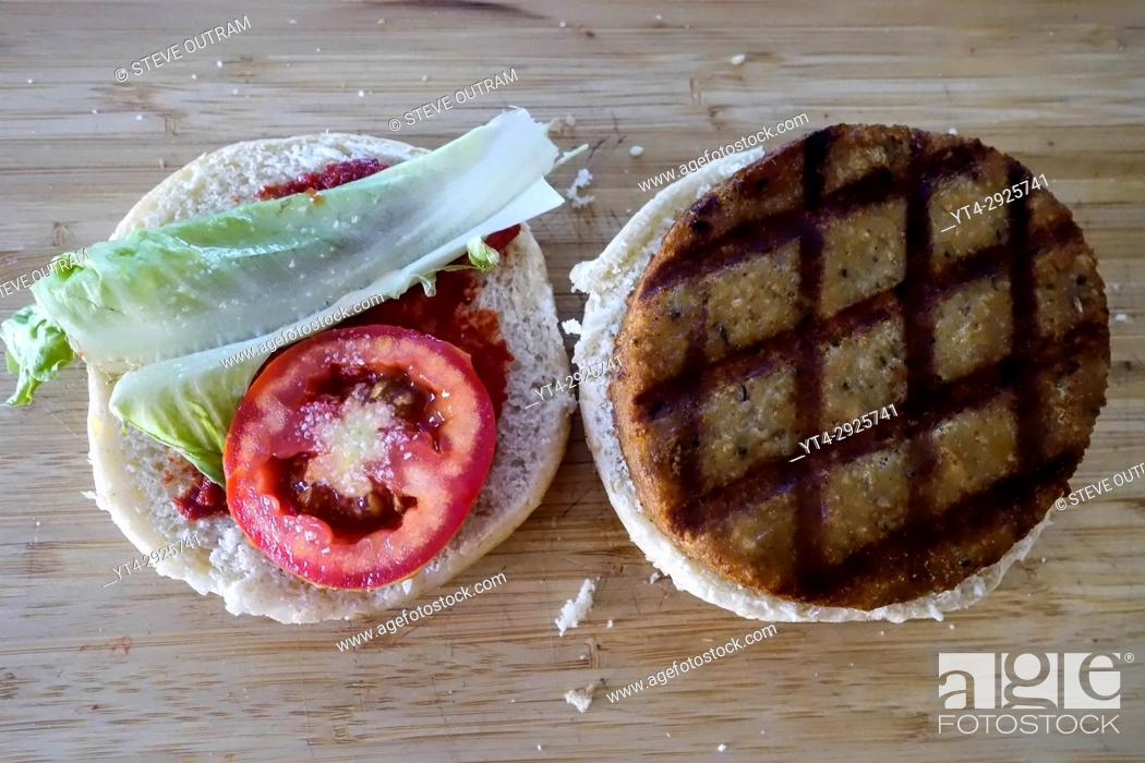 Stock Photo: Preparation of a fresh Chicken Burger.