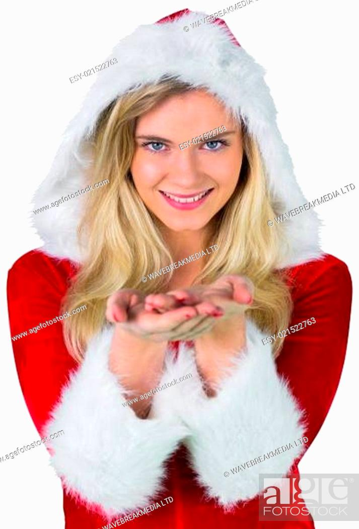 Stock Photo: Pretty girl in santa outfit with hands out.