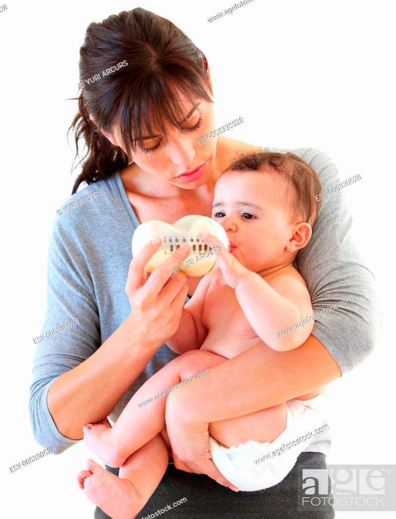 Stock Photo: Studio shot of a mother feeding and cradling her baby.