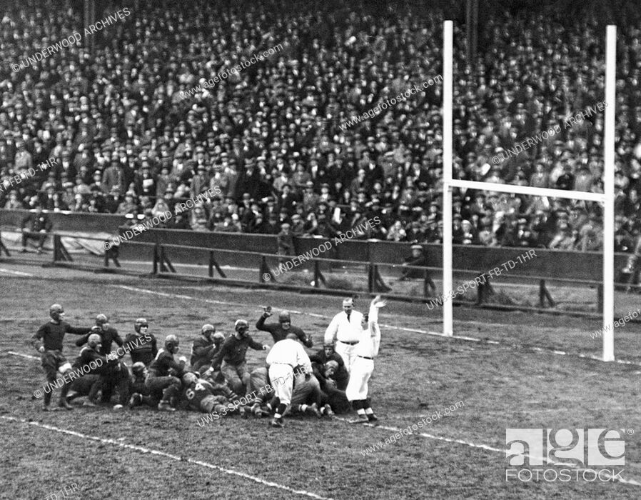 Stock Photo: New York, New York: November 10, 1928. Jack Chevigny of Notre Dame scores a touchdown in the third quarter to tie the game against Army at Yankee Stadium.