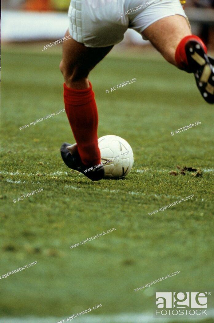 Stock Photo: Football player kicking a ball.