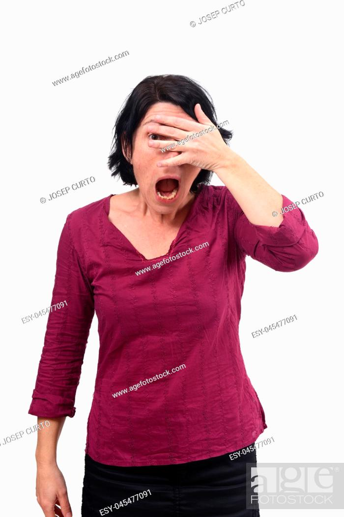 Stock Photo: woman peeking with hand on face on white background.