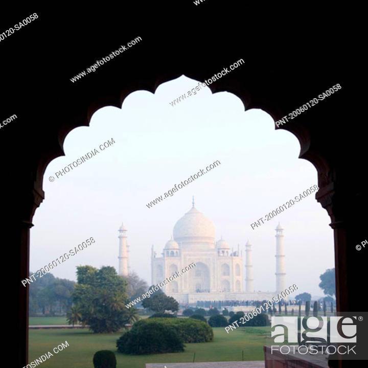 Stock Photo: Mausoleum viewed through an arch, Taj Mahal, Agra, Uttar Pradesh, India.