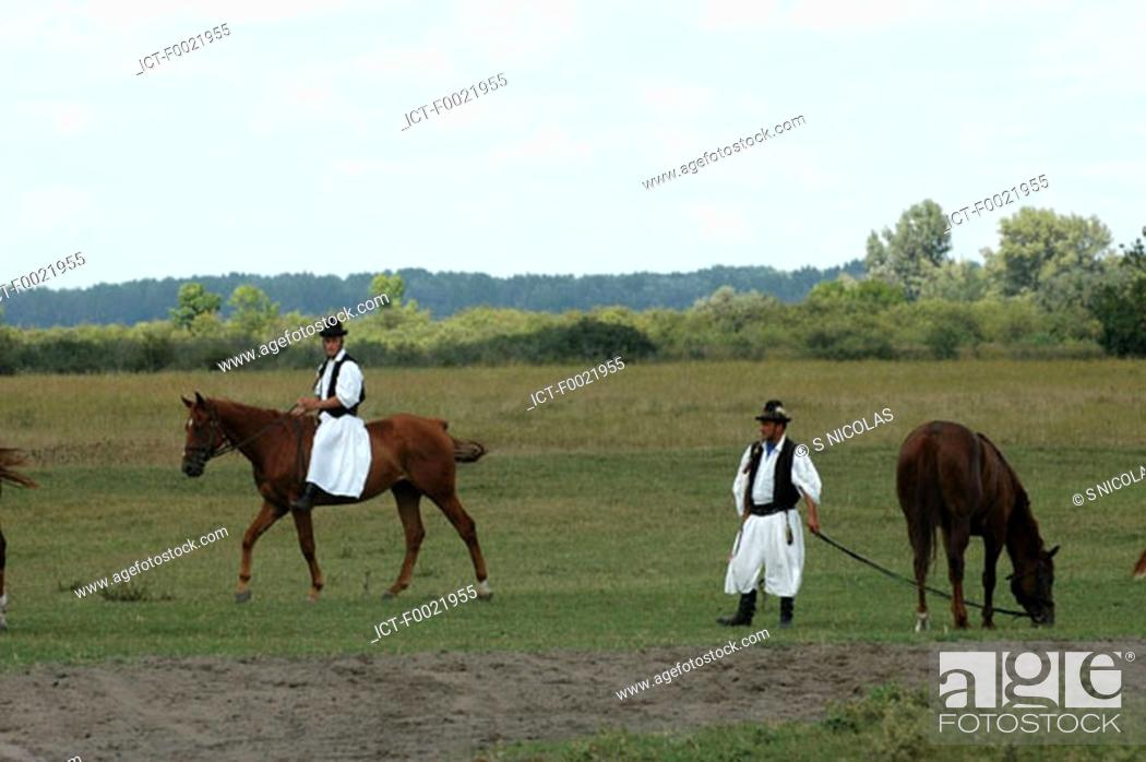 Stock Photo: Hungary, Bugac, the Puszta, Csikos horsemen.