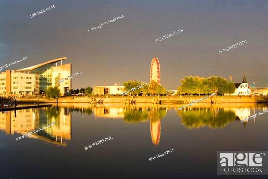 Stock Photo: Government building & Ferris Wheeel in Cardiff Bay, Wales, United Kingdom, Great Britain, Europe.