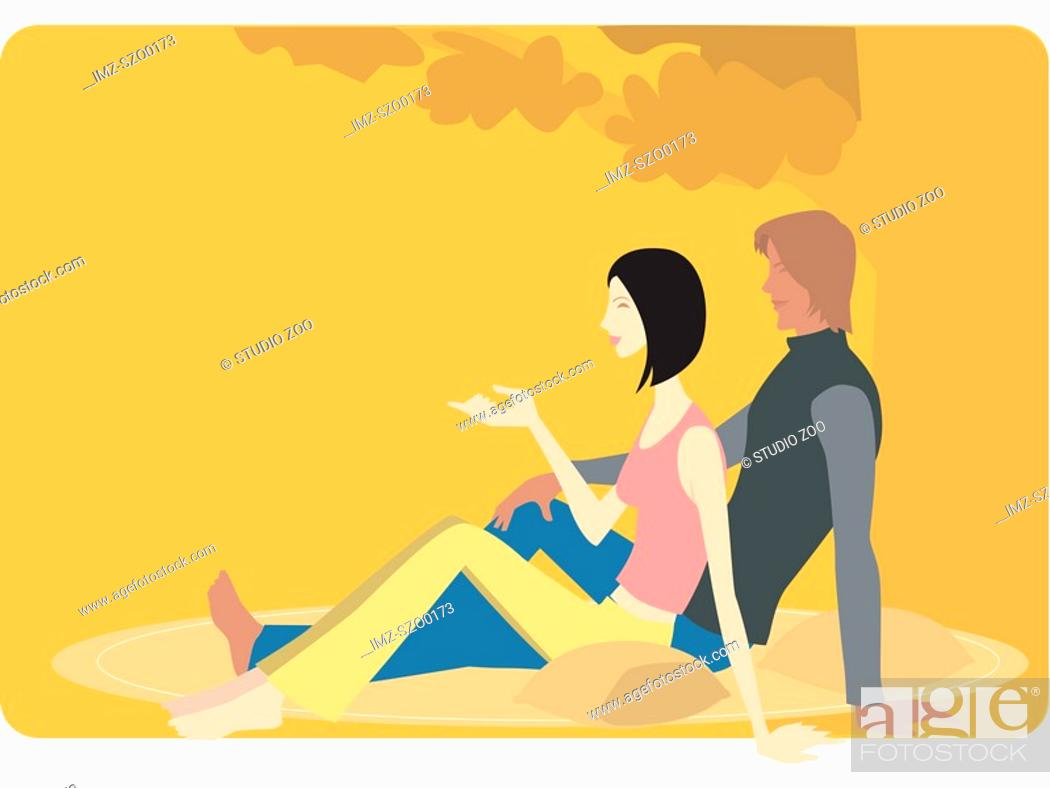 Stock Photo: A man and woman sitting under a tree.