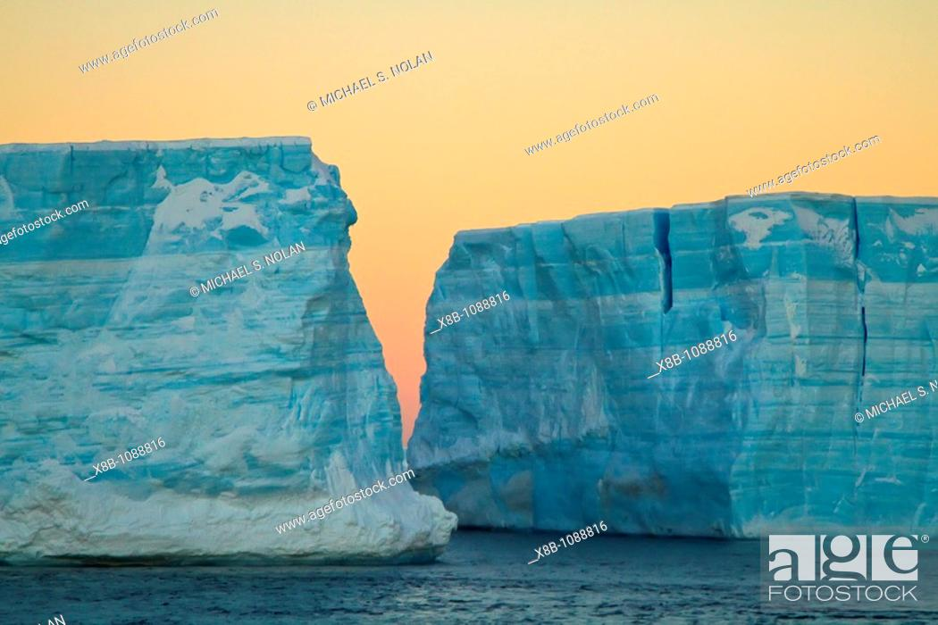 Stock Photo: Huge tabular icebergs and smaller ice floes in the Weddell Sea, on the eastern side of the Antarctic Peninsula  MORE INFO The Weddell Sea is often blocked to.