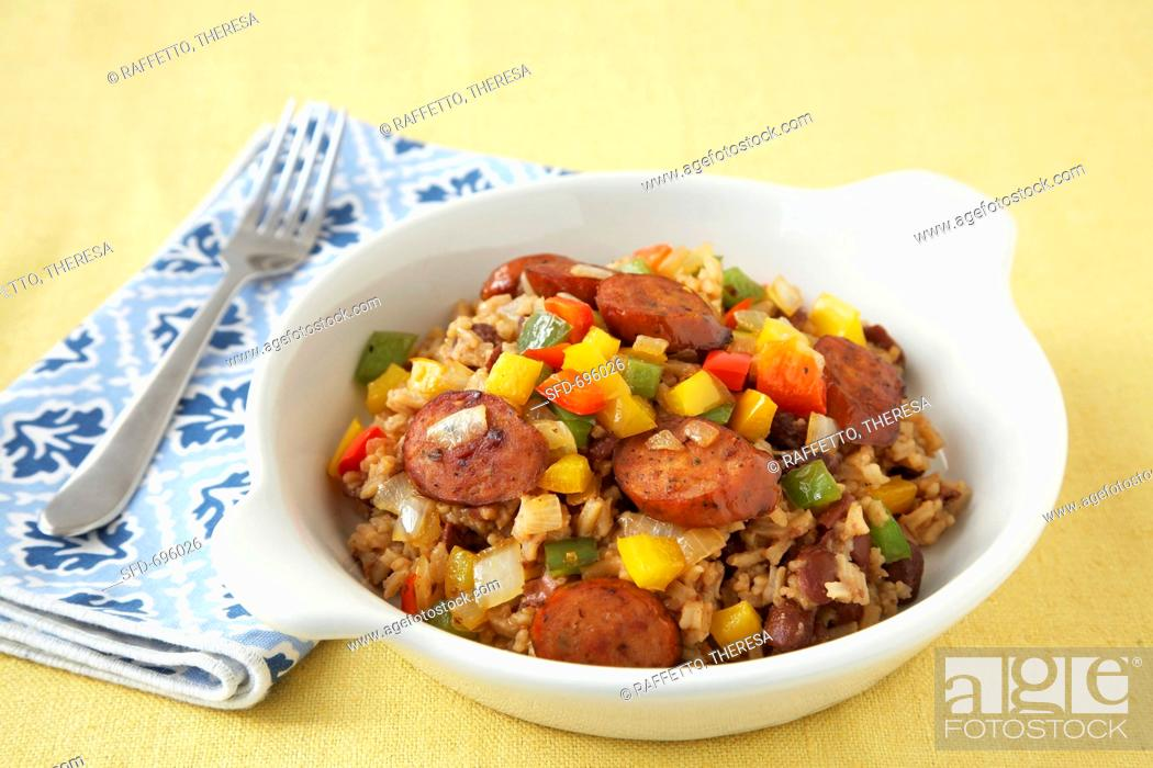 Stock Photo: Cajun Sausage and Peppers with Rice in a White Bowl.