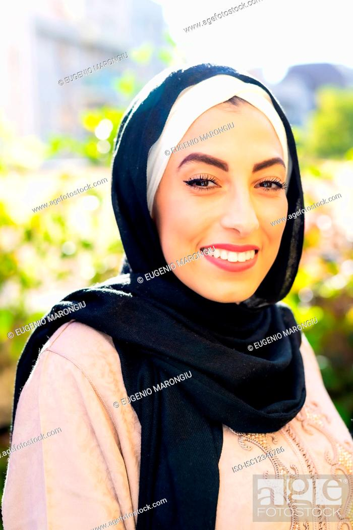 Stock Photo: Portrait of young muslim woman, smiling.