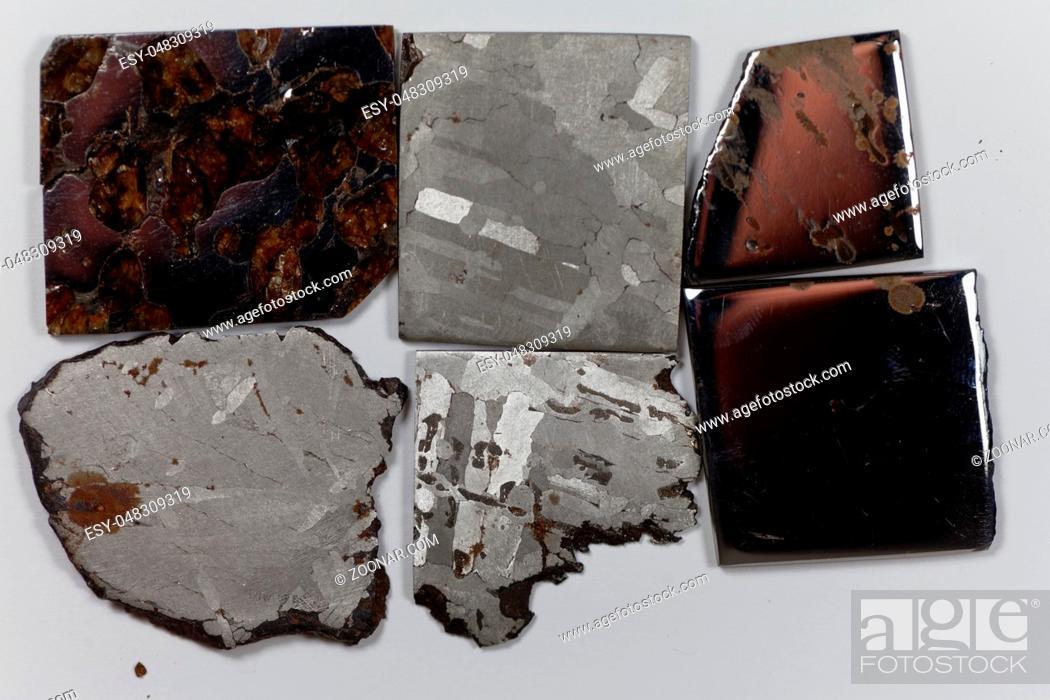 Stock Photo: Iron meteorite pieces on a white background.