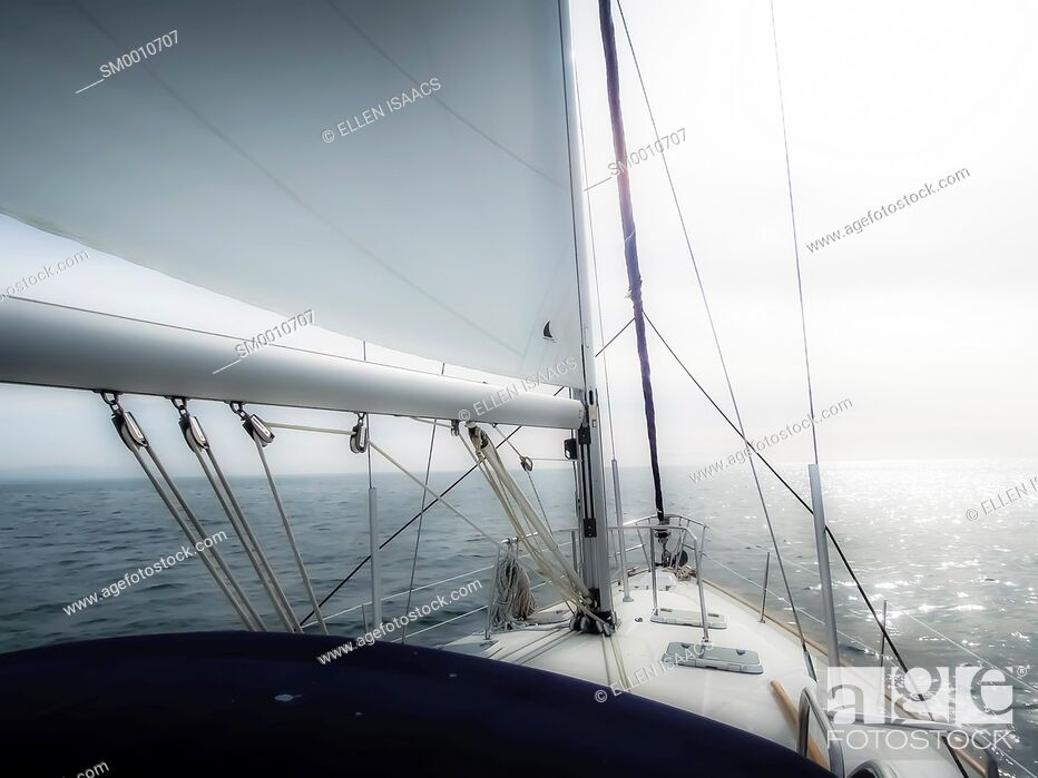 Stock Photo: Sailboat sailing into the horizon with a surreal effect that conveys the idea of going into the unknown future.