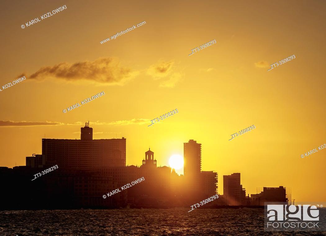Stock Photo: El Malecon, Centro Habana and Vedado at sunset, Havana, La Habana Province, Cuba.