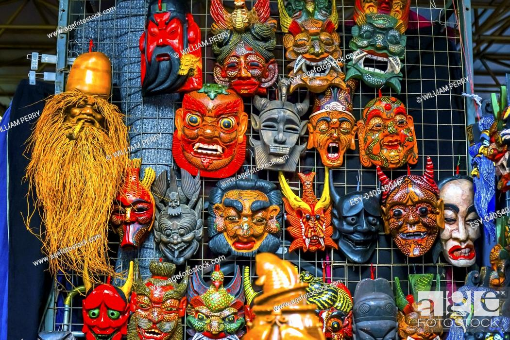 Stock Photo: Chinese Replica Wooden Masks Decorations Panjuan Flea Market Beijing China. Panjuan Flea Curio market has many fakes, replicas and copies of older Chinese.