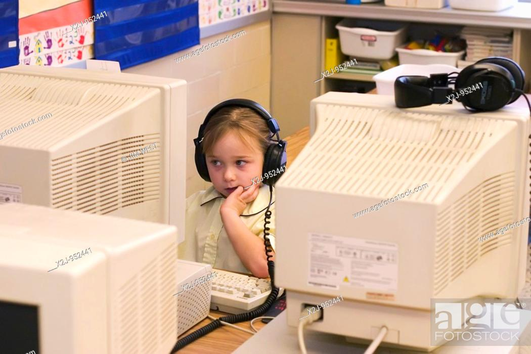 Stock Photo: Toledo, Ohio - A kindergarten girl works on a computer at East Side Central Elementary School in the Toledo public school system.
