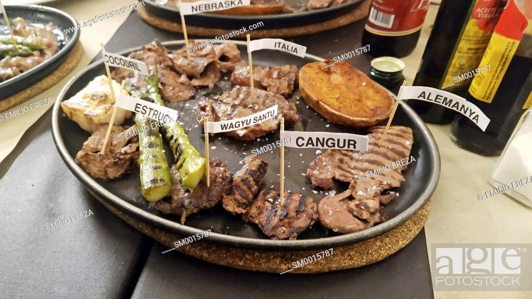 Stock Photo: Varied meats in a restaurant. Barcelona, Catalonia, Spain.