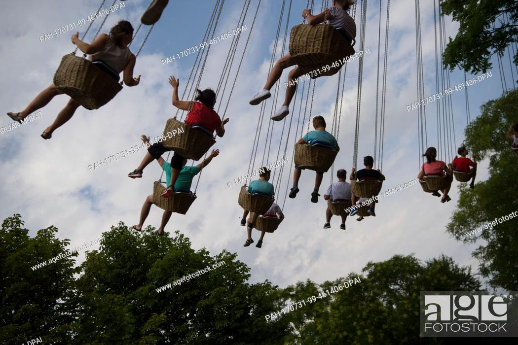 Stock Photo: Visitors take a ride on a chairoplane at the adventure park Tripsdrill in Cleebronn, Germany, 31 July 2017. Photo: Marijan Murat/dpa.