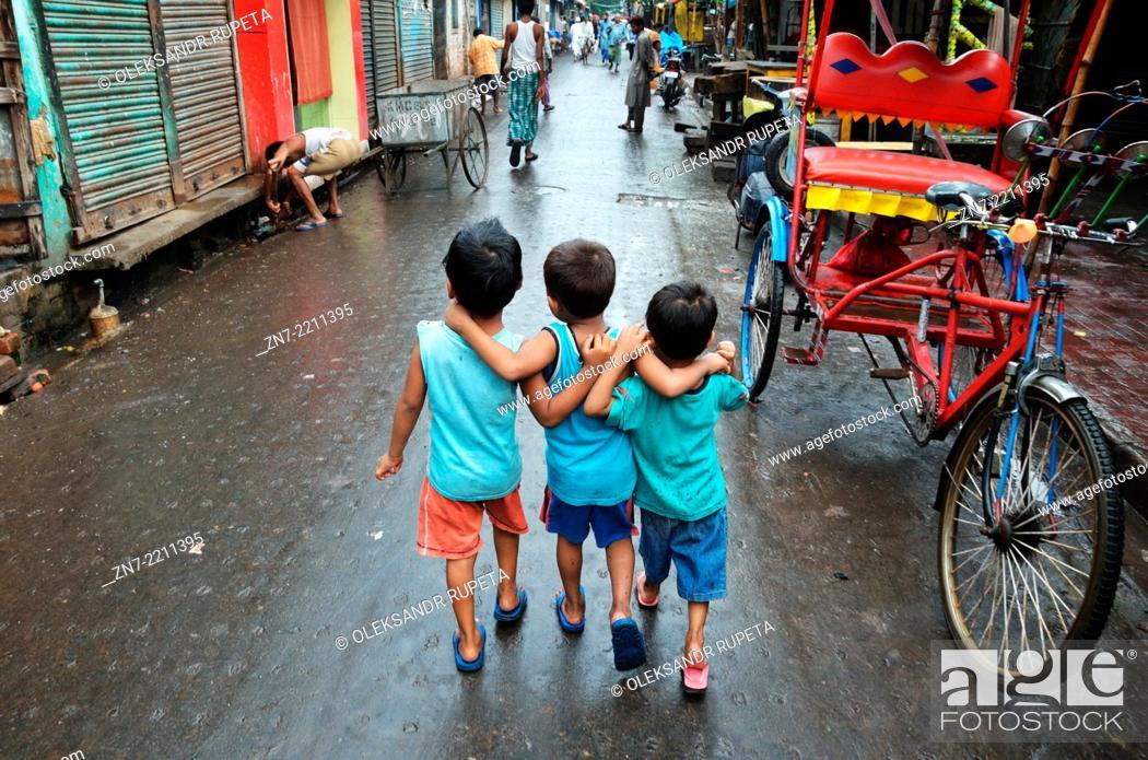 Stock Photo: Children walking on the street in Kolkata.