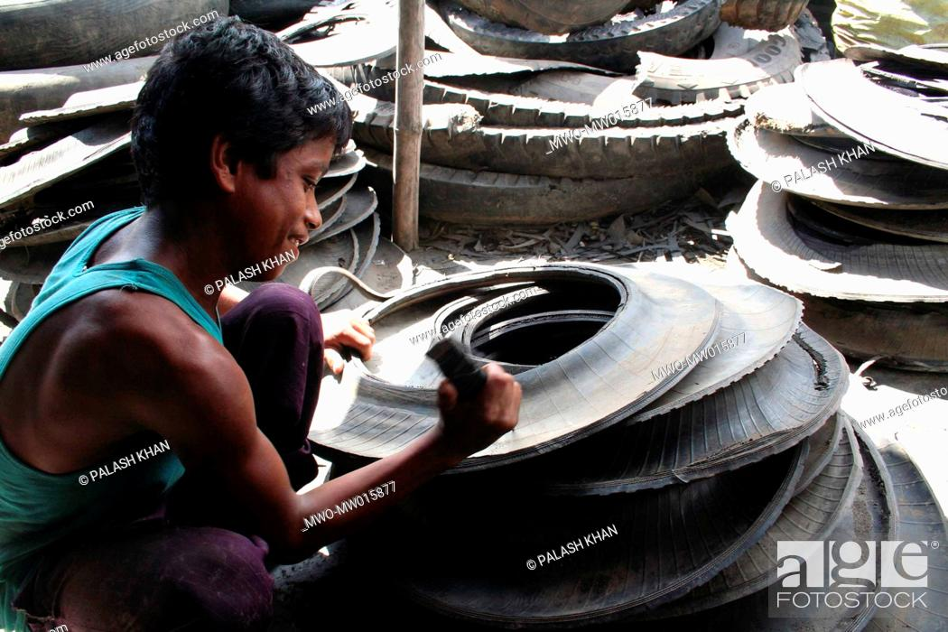 A Boy Working In A Tire Recycling Workshop These Child Workers Are