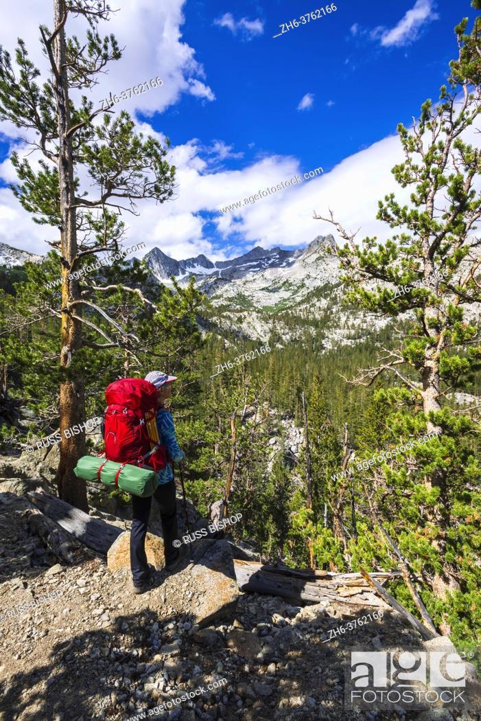 Stock Photo: Backpacker on trail in the John Muir Wilderness, Sierra Nevada Mountains, California USA.