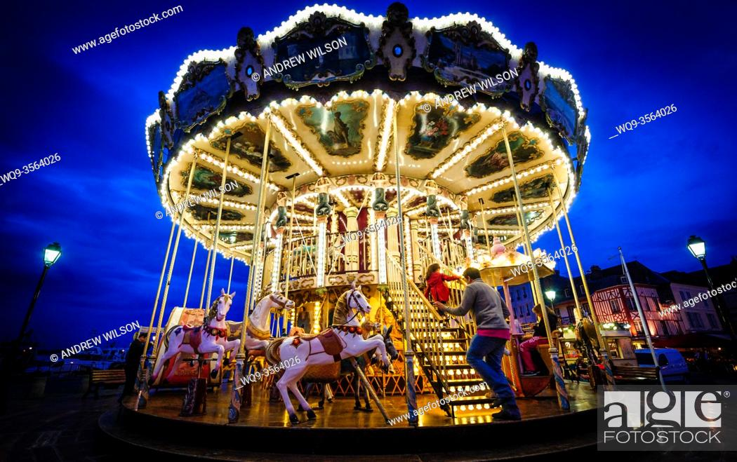 Stock Photo: The famous old carousel which offers rides beside the harbour in Honfleur, France.