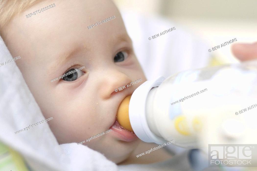Stock Photo: Little boy drinking milk.