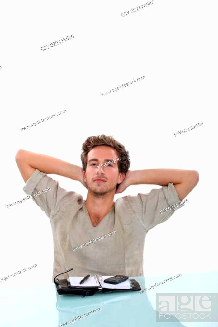 Stock Photo: Man stretching his arms behind his head, taking a break from the personal organi.