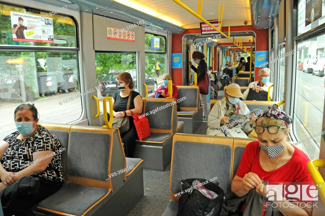Stock Photo: Zürich/Switzerland: Face masks are mandatory now on all public transport, such as tram, train and busses in Switzerland like here in Zürich City.
