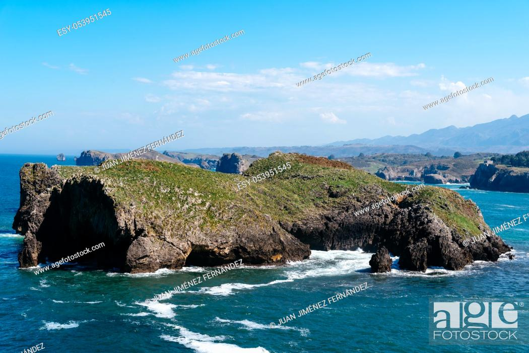 Stock Photo: Scenic view of sea against blue sky in rocky coast. Borizo Beach, Llanes, Asturias, Spain.