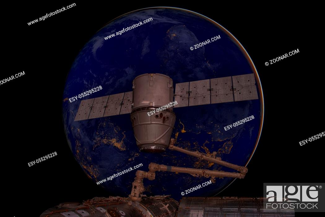 Stock Photo: SpaceX Dragon orbiting the planet Earth. Elements of this image furnished by NASA.