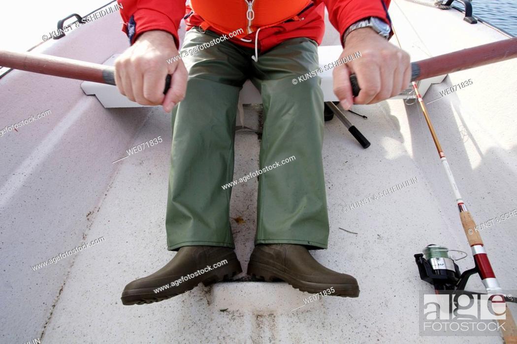 Stock Photo: Man rowing a boat over Gaviksfjärden, Noraström, Västernorrlands län, Sweden, Scandinavia, Europe.