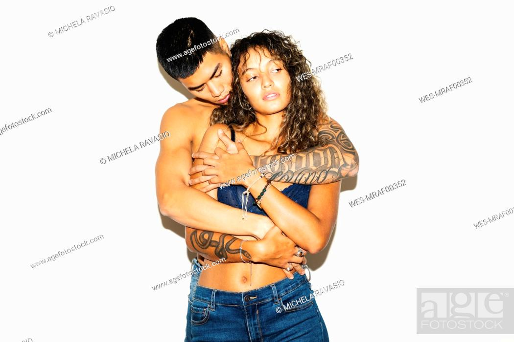 Stock Photo: Young man passionately embracing girlfriend.