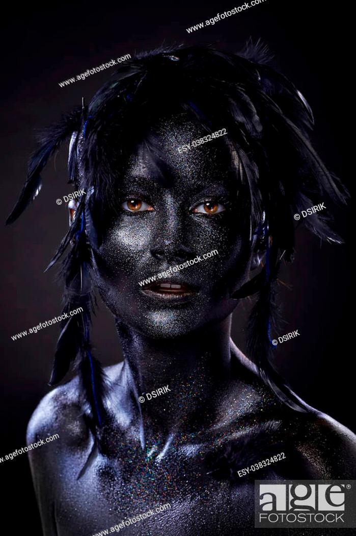 Beautiful Woman With Black Face Over Black Background Creative Body Art Dark Feathers On Head Stock Photo Picture And Low Budget Royalty Free Image Pic Esy 038324822 Agefotostock