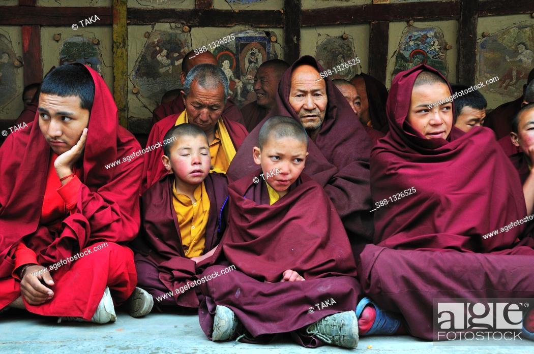 Stock Photo: Buddhist monks watching Chaam Musk Dancing at Hemis Gompa. Jammu and Kashmir, India.