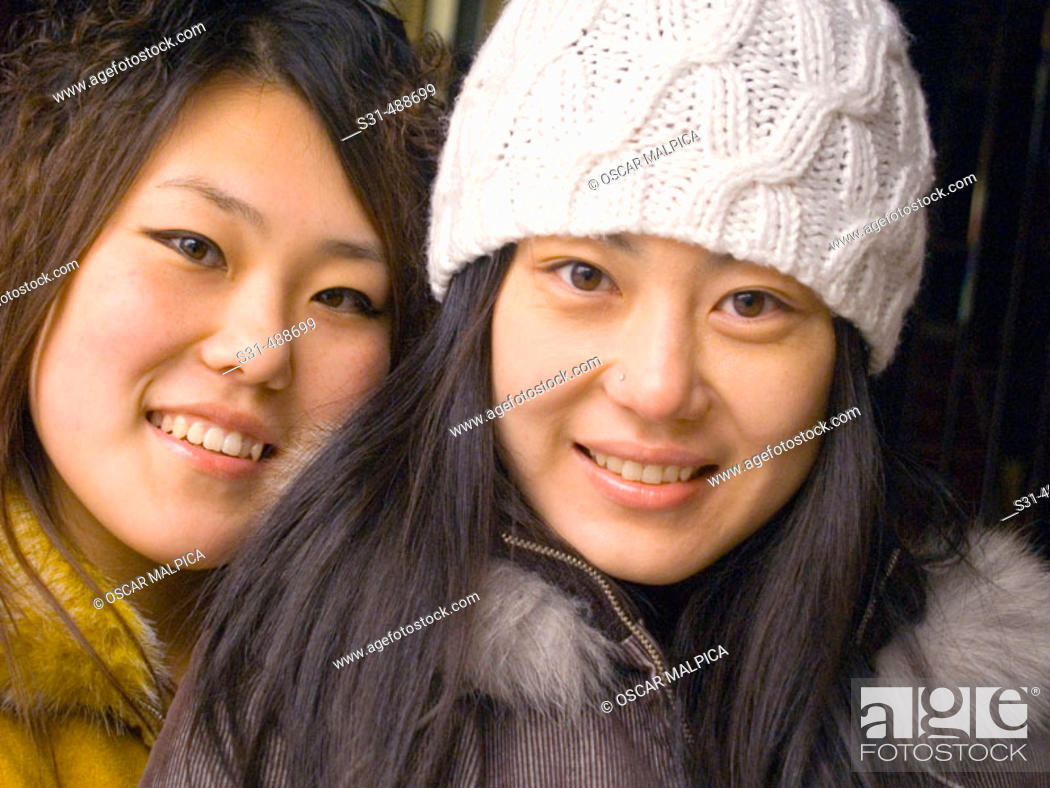 Stock Photo: Close up of Asian sisters.