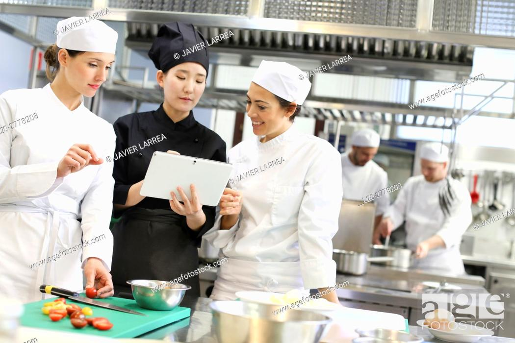 Stock Photo: Chef with tablet, Cooks in cooking school, Cuisine School, Donostia, San Sebastian, Gipuzkoa, Basque Country, Spain, Europe.