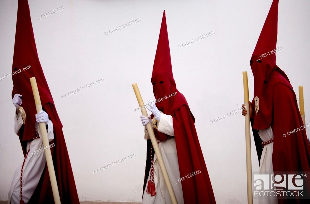 Stock Photo: Penitents walk in a street during Easter Holy Week celebrations in Espera village, Cadiz province, Andalusia, Spain.