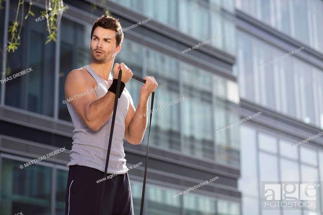 Stock Photo: Man training with fitness band.