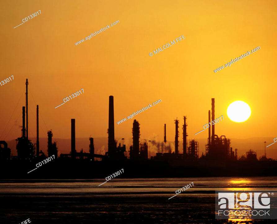 Stock Photo: Oil refinery at sunset. Scotland.