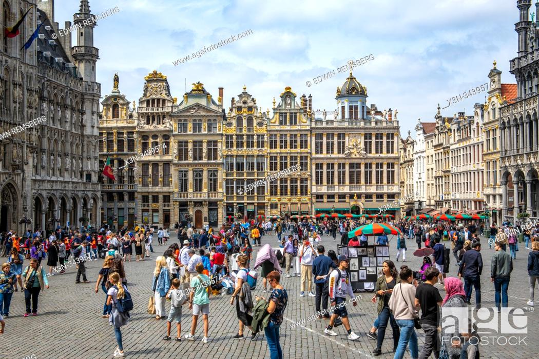 Stock Photo: Tourists walking around the Grand Place and its guild houses, Brussels, Belgium.