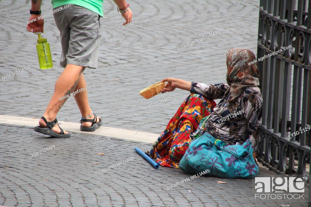 Stock Photo: woman begging outside church in rome italy.