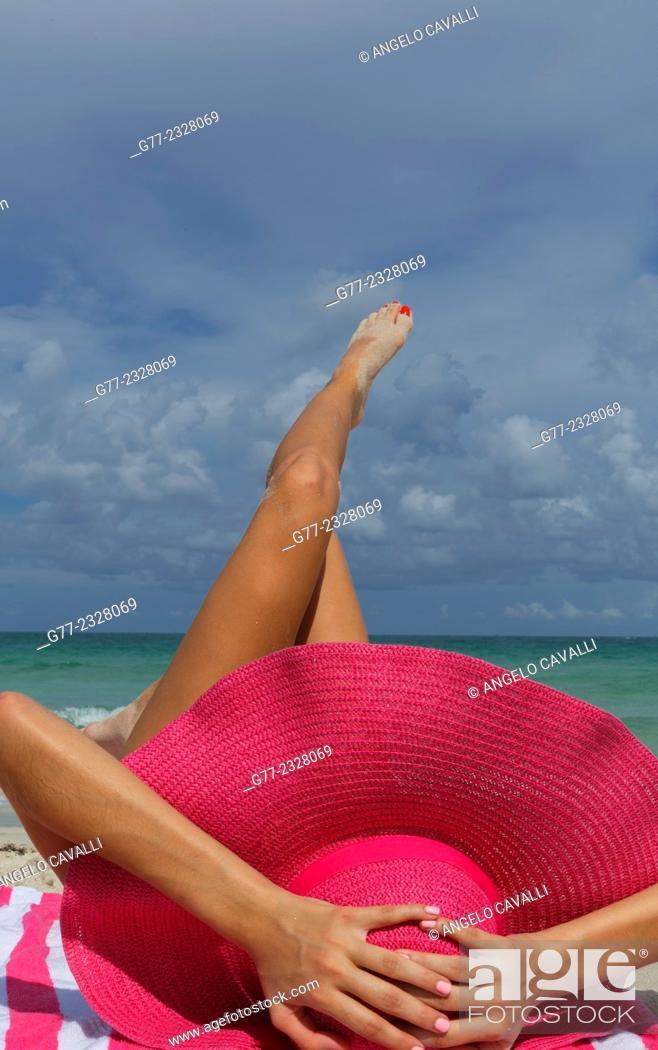Stock Photo: Young woman on the beach. Miami Beach, Florida, USA.