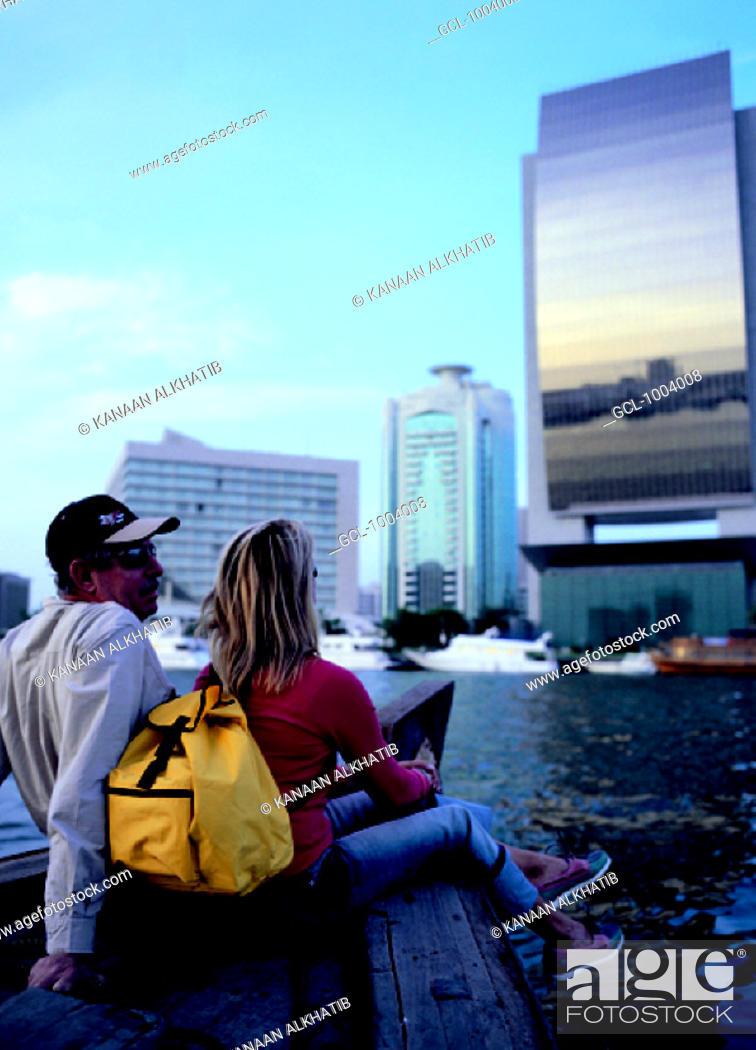 Stock Photo: Western tourists doing a boat tour on the creek in Dubai, United Arab Emirates.