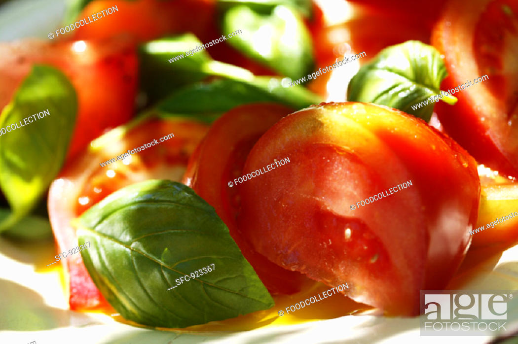 Stock Photo: Tomatoes with fresh basil.