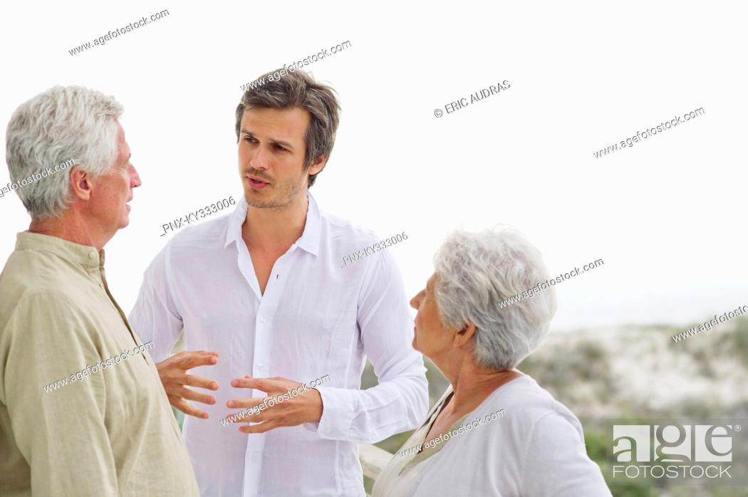 Stock Photo: Mid adult man discussing to his parents.