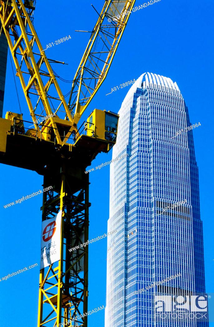 Stock Photo: Construction crane by the IFC skyscraper (China highest building 420m). Hong Kong, China.