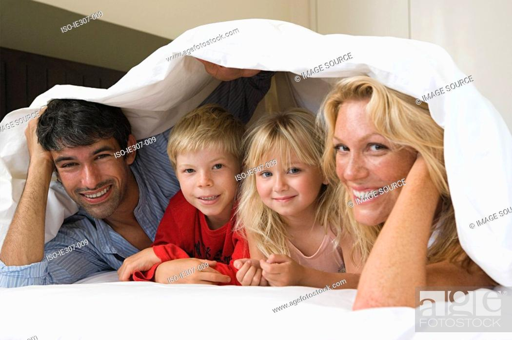 Stock Photo: Portrait of a family in bed.